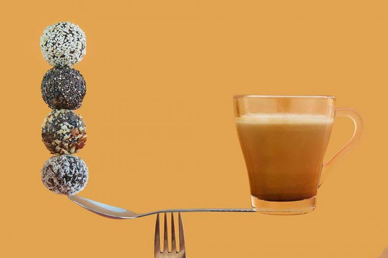 The concept of energy and balance. Healthy homemade energy balls and coffee.