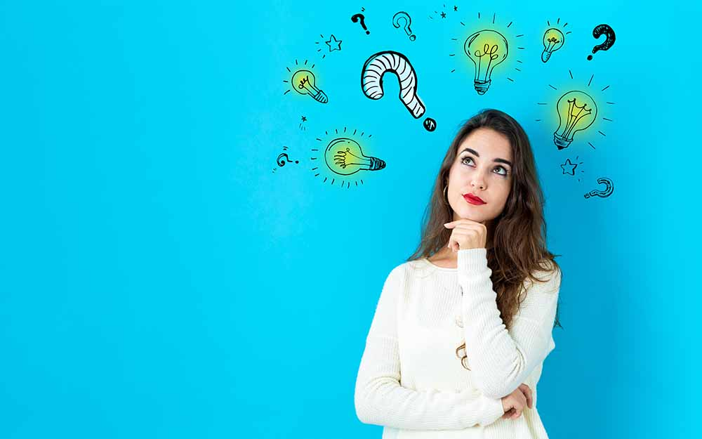 Question with light bulbs with young woman